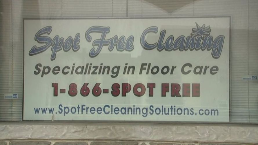 Spot Free Cleaning ad on a building